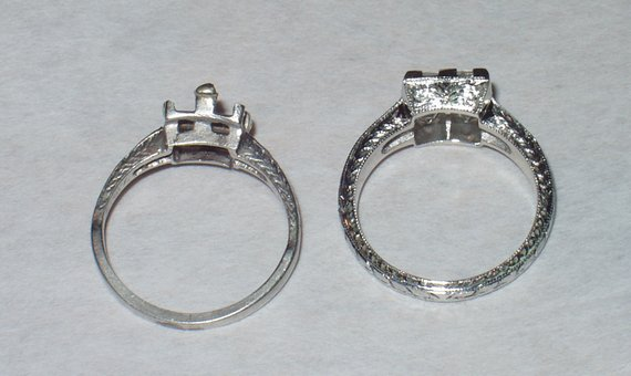 Side view of old worn ring next to new custom ring with matching engraving  Side view of finished platinum ring Side view of finished platinum ring  Top view of diamonds and sapphires Top view of diamonds and sapphires  Antique diamond and sapphire ring